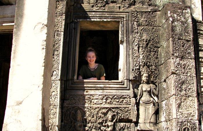 Family holidays in Cambodia - teenager exploring Angkor Wat