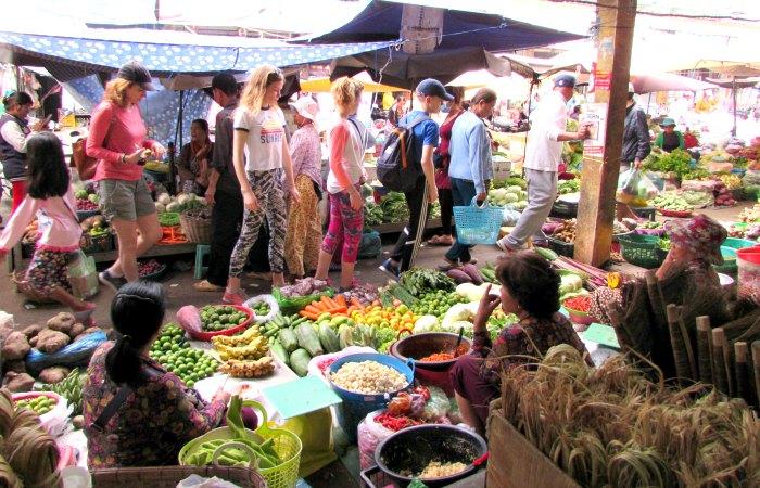 Cambodia family holidays - kids exploring market stalls