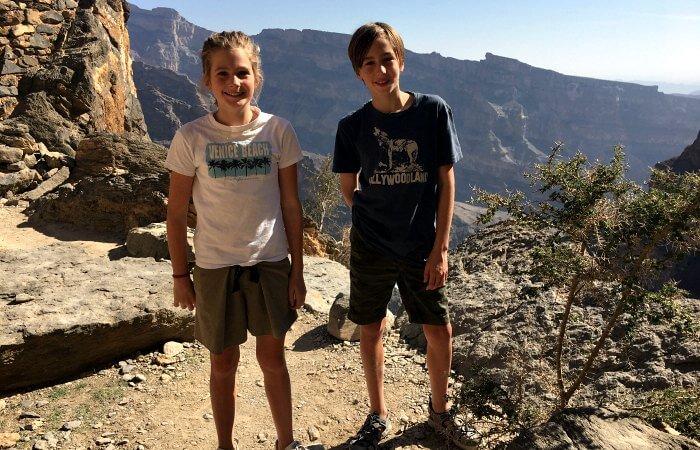Kids enjoying a mountain walk - Oman family holidays