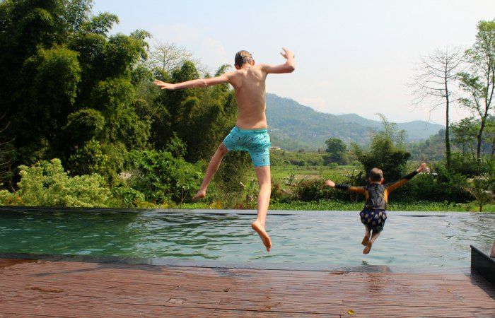 Nepal family holidays - kids jumping in a pool