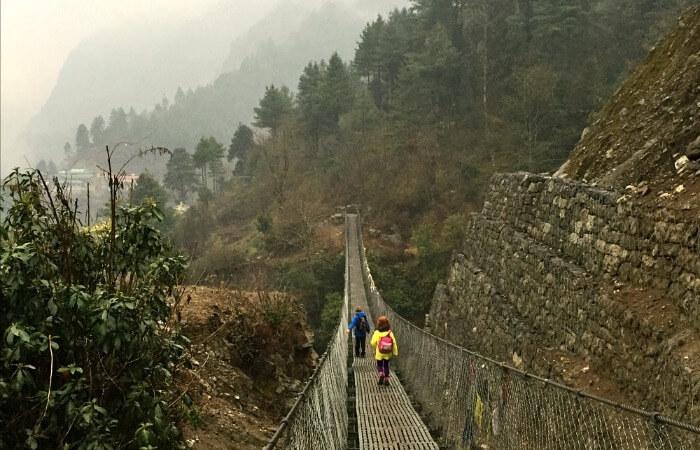 Nepal family holidays - kids trekking on a misty morning