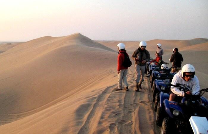 Namibia family holidays - quad biking in the dunes near Swakopmund