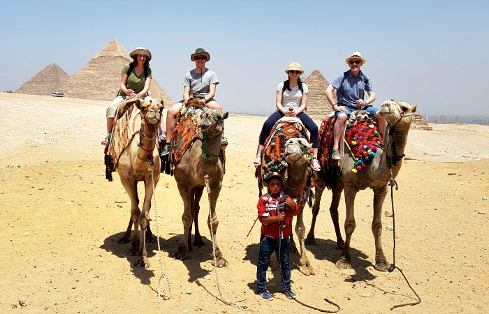 Egypt customer reviews - family riding camels at the Pyramids