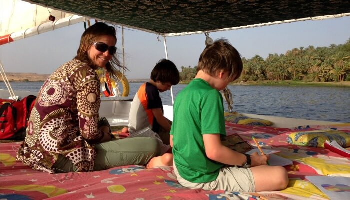 Where to stay in Egypt - family sitting on comfortable Felucca deck