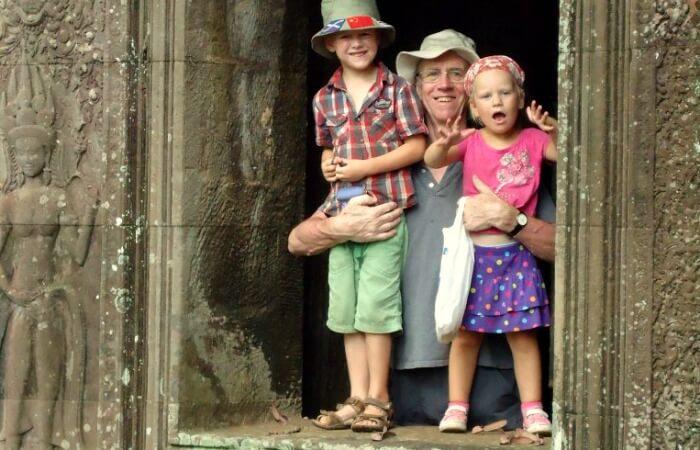 Long haul family holidays - the kids at Angkor Wat Cambodia with grandad