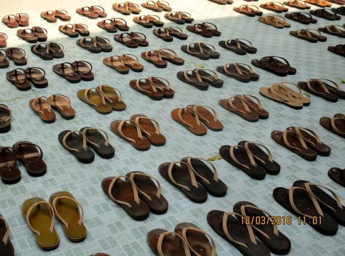 National Geographic kids award - Burma Myanmar - shoes carefully lined up at a convent