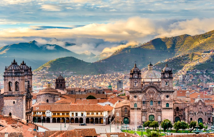 Peru with kids - peru with Children - Cusco in its dramatic setting high in the Andes