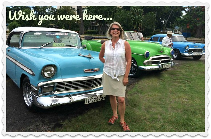 Postcard from Cuba - blogger Helene beside vintage cars in Havana