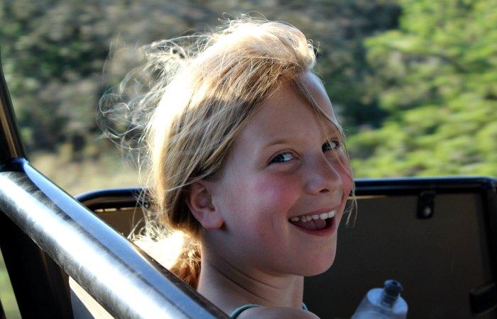 Excited young girl on safari