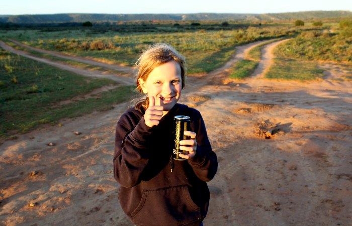 Young girl enjoying a sundowner drink on a family safari