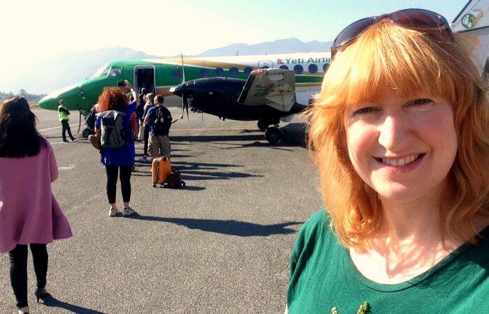 Nepal photo blog - Kelly on plane back to Kathmandu