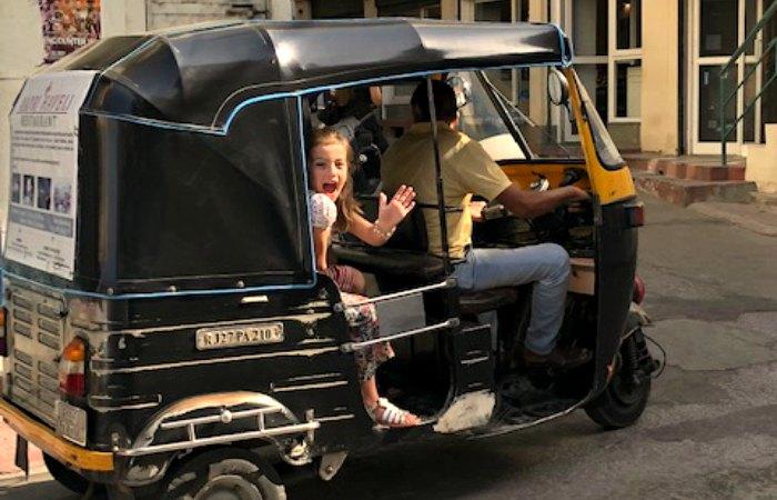 Kids enjoying a tuk tuk ride - India with kids itinerary