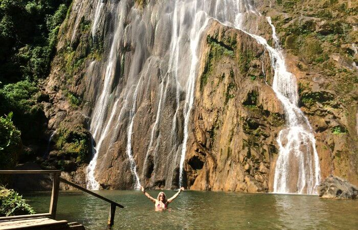 Boca da Onca Falls - Helene in front of waterfall having a dip