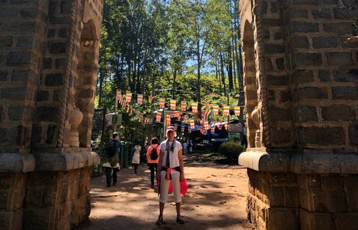 700x450 50th birthday celebration abroad - Standing under historic arch