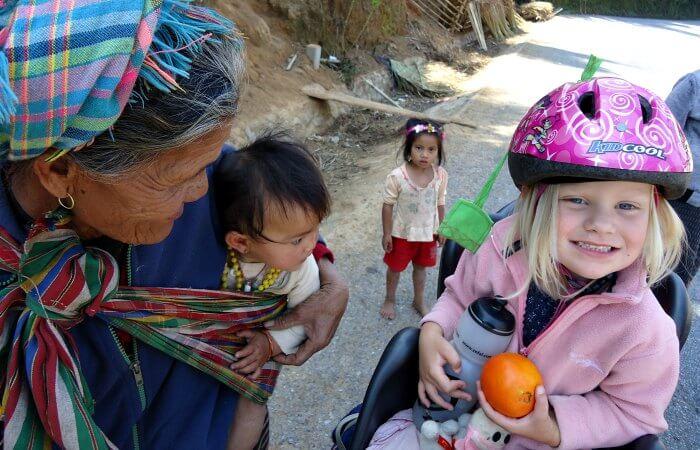Laos family holidays - meeting local family - family adventure holiday