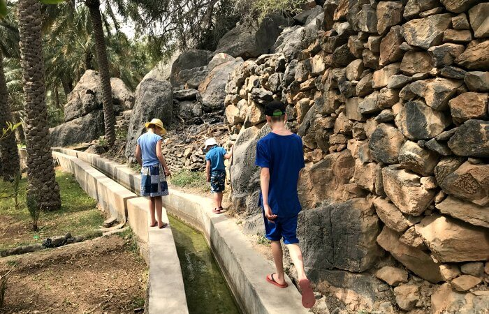 Oman for kids itinerary - children exploring Misfah Oasis