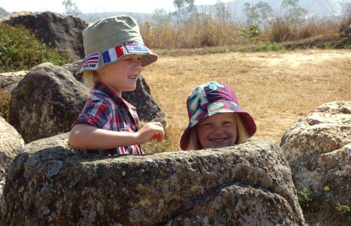 Kids exploring the Plain of Jars - Laos family holidays