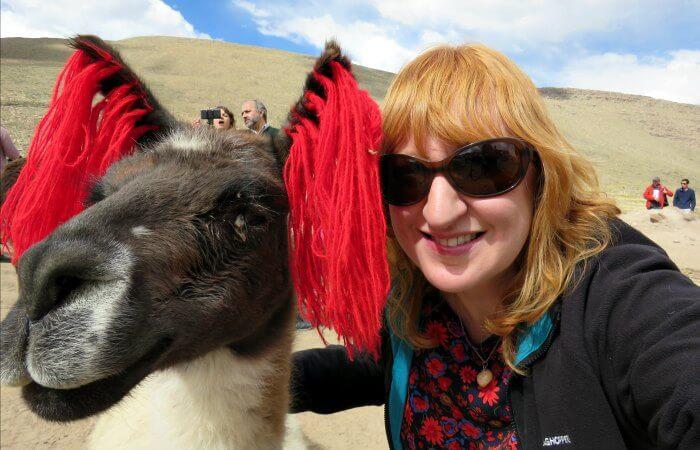 Touring Peru - Kelly with llama