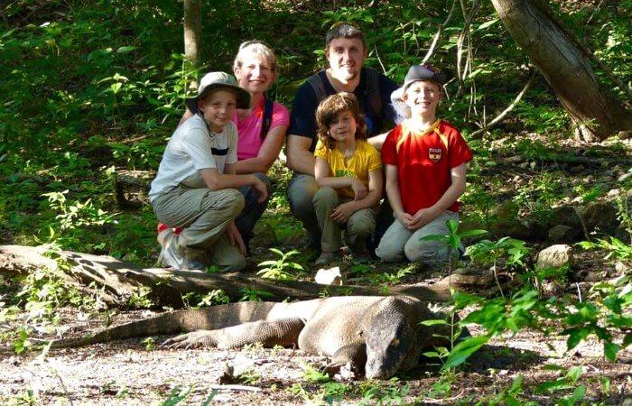 Family look at a dozing Komodo Dragon in Bali - family wildlife holiday