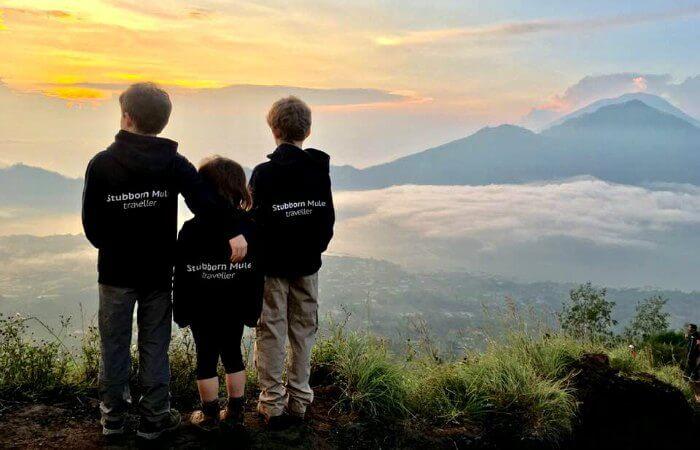 Three children in Bali overlooking the valley below