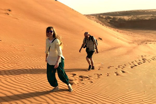 Father and daughter walking in the dunes - Wahiba Sands