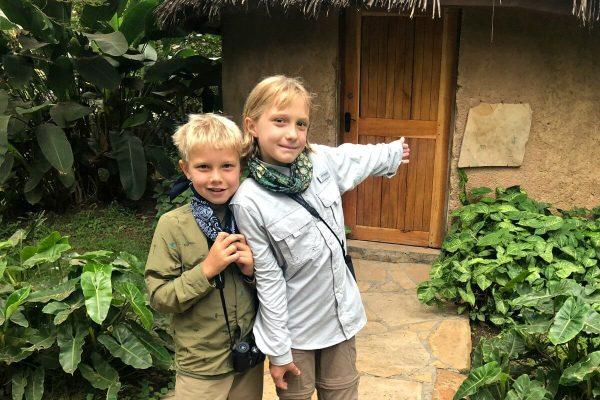 Kids holidays abroad - kids outside boma on a holiday to Tanzania