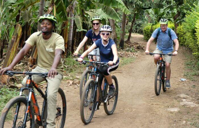 Kids on Tanzania holiday, cycling through banana plantations