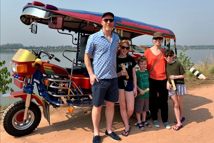 Laos family holidays - Tuk tuk ride along the Mekong in Vientiane