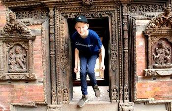 Boy exploring temple in Nepal - School holiday calendar