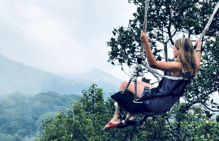 Girl on Bali swing - holidays with teenagers