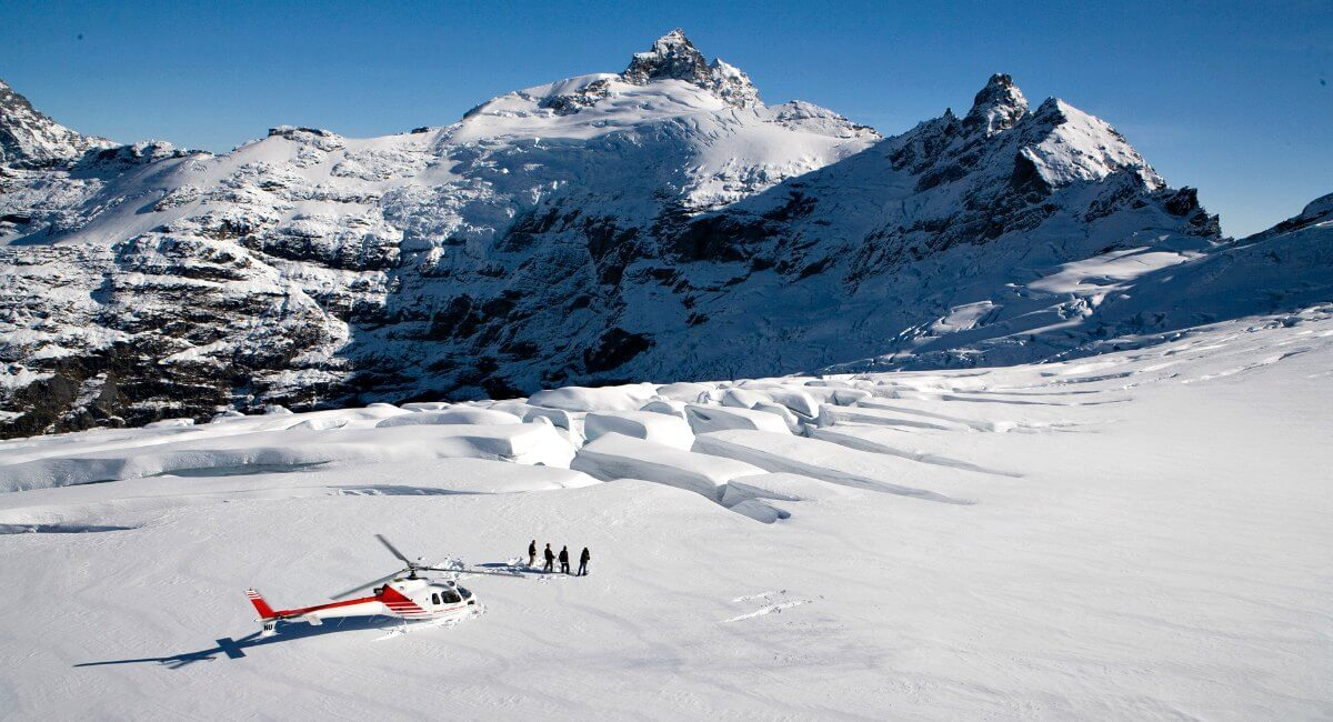 New Zealand in Pictures - Clarke Glacier - helicopter bringing people for glacier hike