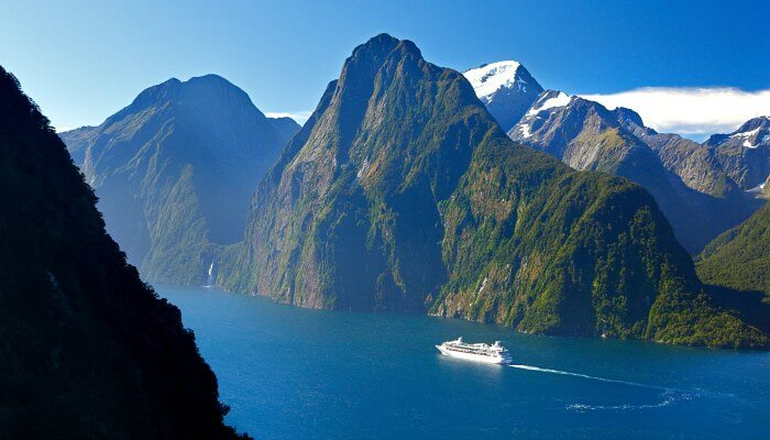 Boat in Milford Sound Fiordland by Rob Suisted