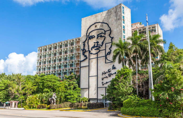 Che Guevara stencil on Ministry of Interior - Havana - Cuba with children holiday