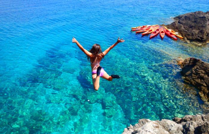 Croatia family holidays - girl jumping into the Adriatic